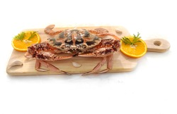 Fresh Crucifix Crab decorated with herbs and fruits on a wooden pad.Isolated on white background.Selective focus.