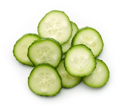 Fresh cucumber slices isolated on white background, top view