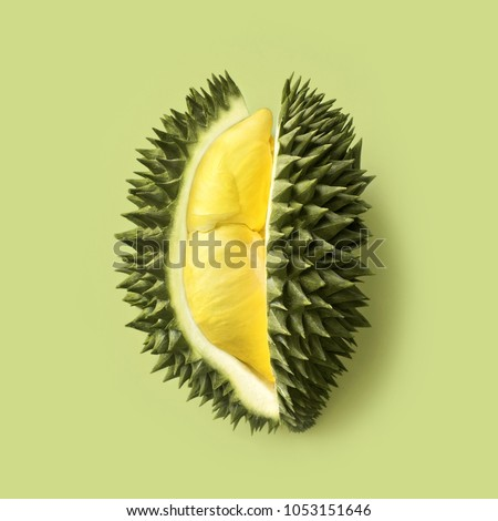 Fresh cut durian on a pastel green background, king of fruit from Thailand