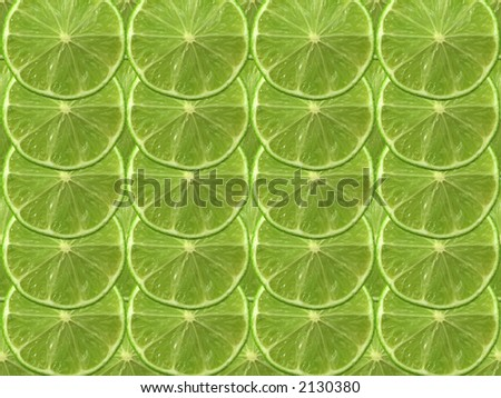 fresh cut green lime on a plain background