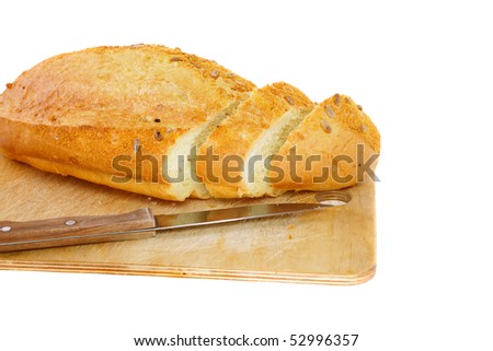 Fresh cutting bread. Isolated over white