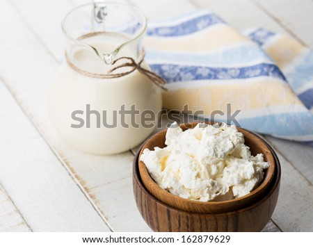 Fresh dairy products - cottage cheese, milk.  Rustic style. Bio/organic/natural ingredients. Healthy eating.