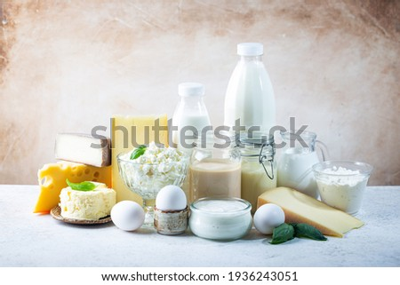 Fresh dairy products, milk, cottage cheese, eggs, yogurt, sour cream and butter on white table Foto stock ©