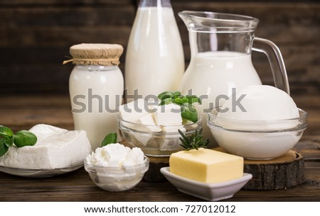 Fresh dairy products on the wooden table  #727012012