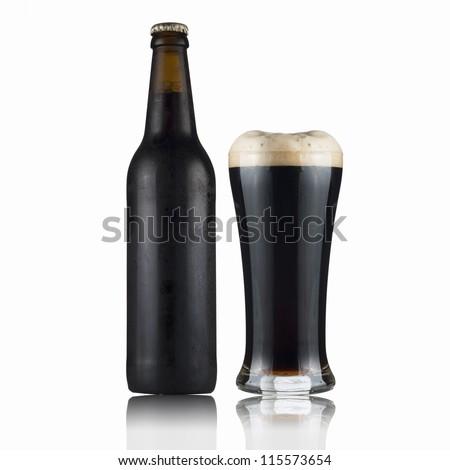 Fresh dark beer bottle and glass.