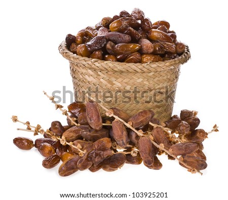 Fresh dates  in a wicker basket isolated on white background