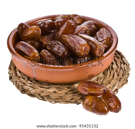 Fresh dates   in ceramic bowl isolated on white background - stock photo