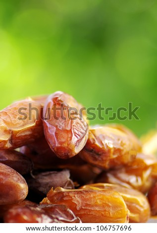 Fresh dates isolated on green background