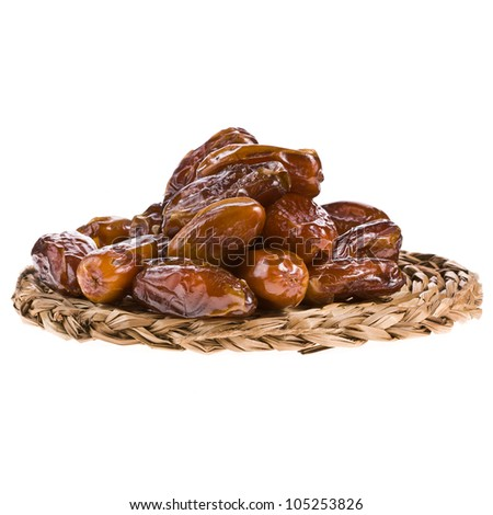 Fresh dates on a palm mat isolated on white background