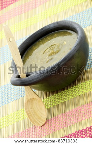 fresh delicious,flavorful tomatillo sauce in colombian clay dish