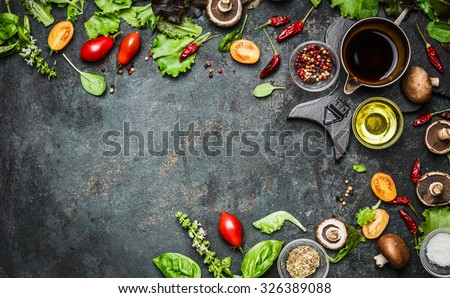 Fresh delicious ingredients for healthy cooking or salad making on rustic background, top view, banner. Diet or vegetarian food concept.