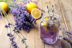 Fresh delicious lemonade with lavender in masson jar on wooden table