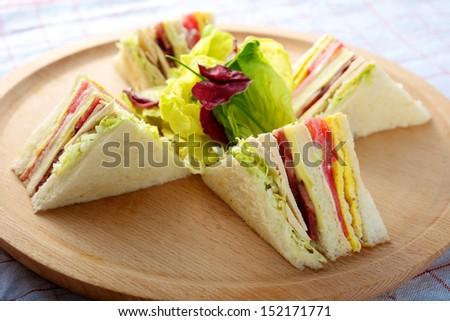 Fresh delicious Turkey Club Sandwich on cutting board