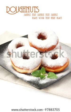 Fresh dough-nuts with icing sugar