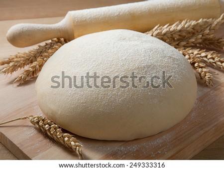 Fresh dough on the table.