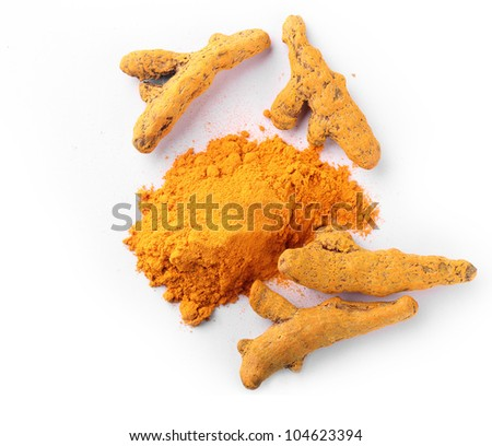 Fresh, dried and powdered turmeric root which is known for its medicinal properties and its use in ayurvedic and herbal medicines in India for centuries. It's also known for anti-cancer properties. - stock photo