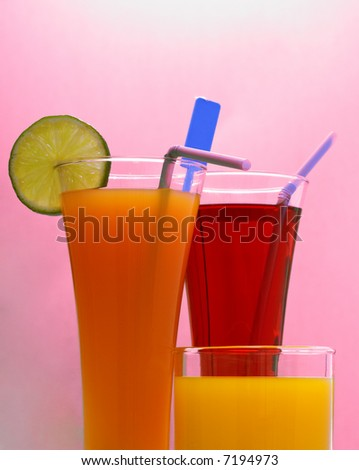 fresh drinks in front of a pink background