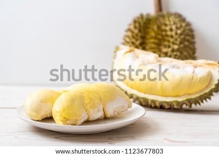 Fresh Durian Fruit on wood background