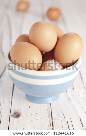 Fresh egg in the blue bawl - stock photo