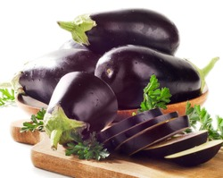 Fresh eggplants on a wooden border isolated on white background . Selective focus