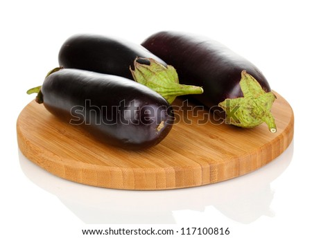 Fresh eggplants on chopping board isolated on white