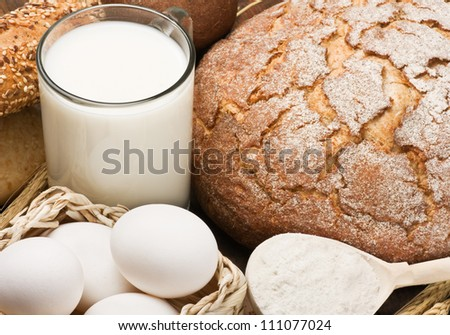 fresh eggs and a lot of different breads - stock photo