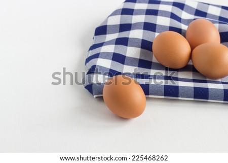 Fresh Eggs on blue dish cloth