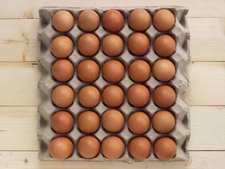 Fresh eggs on paper egg box.  Food ingredient for hight protein. Top view.