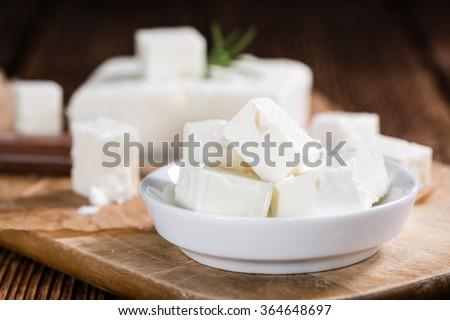 Fresh Feta Cheese (detailed close-up shot) on vintage background