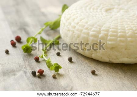 fresh feta cheese on wooden board