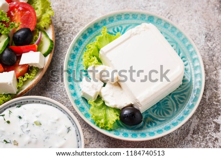 Fresh feta cheese with olives on light background #1184740513