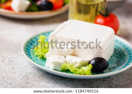 Fresh feta cheese with olives on light background #1184740516