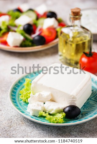 Fresh feta cheese with olives on light background #1184740519