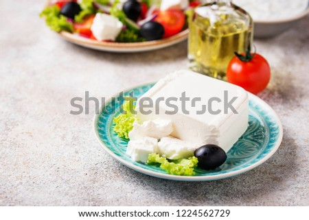 Fresh feta cheese with olives on light background #1224562729