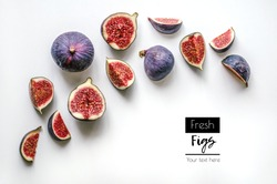 Fresh figs.Food Photo. Creative diagram of a whole and sliced â??â??figs on a white background with space for text. View from above. Copy space