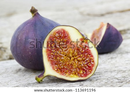 Fresh figs on old wooden background - stock photo