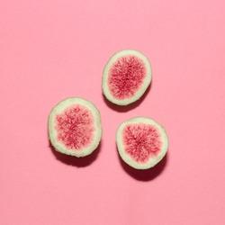Fresh figs on pink background.Vanilla Fashion Style