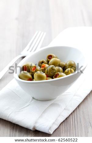 fresh filled olive in white bowl