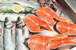 Fresh fish and seafood. Healthy eating concept. Top view. Showcase with chilled red fish in grocery store. Market place, showcase with sea food. Retail sale, marketplace.
