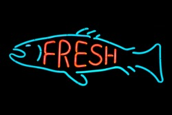 Fresh fish neon sign isolated on black background