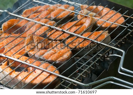 Fresh fish on grilling sticks