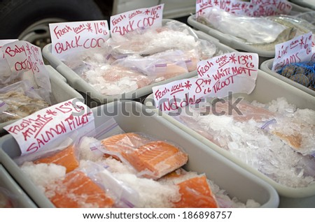 Fresh fish on ice at an open air farmers market.