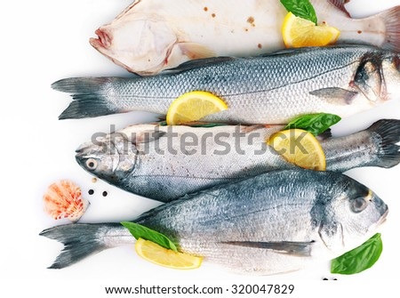 Fresh fishes and shrimps with spices  close up