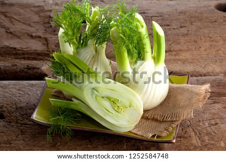 Fresh Florence fennel bulbs or Fennel bulb on wooden background. Healthy and benefits of Florence fennel bulbs Foto stock ©