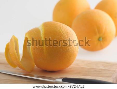 fresh florida navel ogange peel knife fruit citrus organic - stock photo