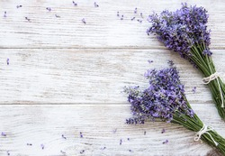 Fresh flowers of lavender bouquet on a white wooden background