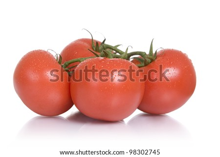 Fresh foods: four vine-ripened tomatoes, white background.
