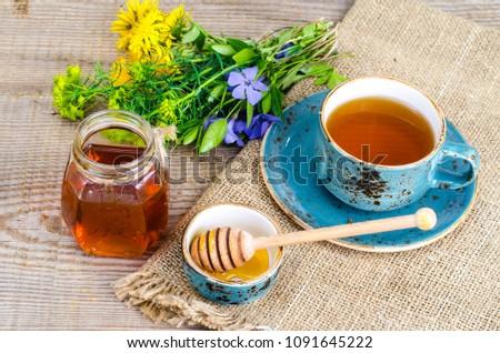 Fresh fragrant tasty honey from wild plants. Studio Photo