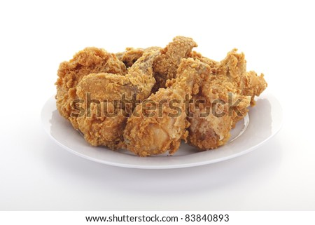 Fresh fried chicken on a white plate