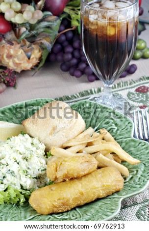 Fresh fried fish and chips with delicious coleslaw and a glass of iced tea